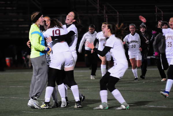 JIM VAIKNORAS/Staff photo The Newburyport girls soccer celebrate after defeating Swampscott to claim the North Sectional championship at Manning Field in Lynn Sunday Night.
