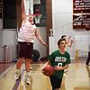 BRYAN EATON/Staff photo. Newburyport High basketball hopefuls do some layups.