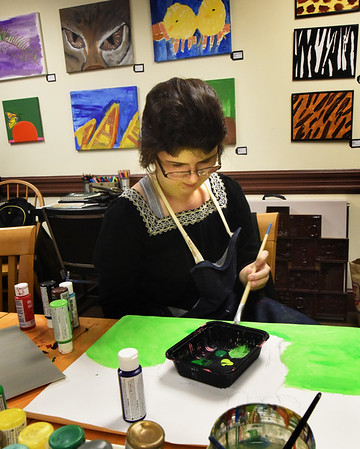 BRYAN EATON/Staff photo. Emily works on a piece at Able HeART in Amesbury.