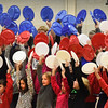 "BRYAN EATON/Staff photo. Cashmnan School chorus members wave red, white and blue plates creating the United States flag as they sang ""America, the Beautiful."" They were holding their annual Veteran's Day assembly on Thursday morning."