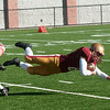 JIM VAIKNORAS/Staff photo Newburyport's Robert Johnston dives for extra yardage at the Newburyport/Amesbury Thanksgiving football game at World War Memorial Stadium in Newburyport Thursday.