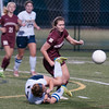 JIM VAIKNORAS/Staff photo  Newburyport's Colleen Byron collides with with Lynnfield's Sydney Santosousso during their game Monday. The Clippers defeated Lynnfield in Lynnfield 1-0 in overtime.