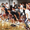 BRYAN EATON/Staff photo. Prospective Newburyport High basketball players practice ball handling skills.