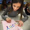 BRYAN EATON/Staff photo. Eva Tiezzi, 9, and friends at the Boys and Girls Club in Salisbury wrote Christmas card to a girl named Ruby Mae Millea of Swampscott. They saw on the news the 4-year-old was diagnosed with stage 4 neuroblastoma earlier this year and is at the Floating Hospital for Children at Tufts Medical Center and was cheered by receiving Christmas cards so they decided to create some and send them along.