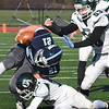 BRYAN EATON/Staff photo. Pentucket defenders take down Triton's Jake MacInnis.