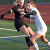 BRYAN EATON/Staff photo. Margaret Cote moves the ball past a Wayland player.