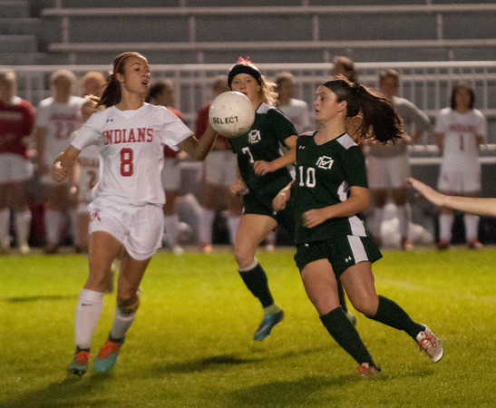 JIM VAIKNORAS/Staff photo Manchester-Essex player Claire O'Brien and Amesbury's Ashley Pettet go for a loose ball at Landry Stadium in Amesbury Friday night.