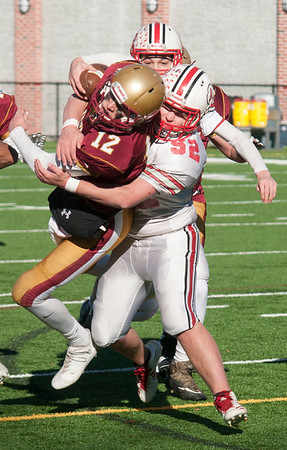 JIM VAIKNORAS/Staff photo Newburyport'sOwen Bradbury is tackled by Amesbury's Jacob Hamel at the Newburyport/Amesbury Thanksgiving football game at World War Memorial Stadium in Newburyport Thursday.