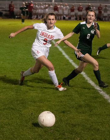 JIM VAIKNORAS/Staff photo Manchester-Essex player Helena Taraska and  Amesbury's Michaela Halloran fight for the ball at Landry Stadium in Amesbury Friday night.