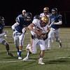 JIM VAIKNORAS/Staff photo Newburyport's Seamus Webster fights for yardage at Lynnfield Friday night.