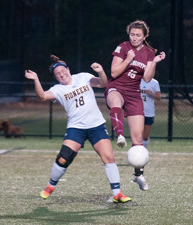 JIM VAIKNORAS/Staff photo  Newburyport's Colleen Byron makes a play for the ball with Lynnfield's Olivia Montanile during their game Monday. The Clippers defeated Lynnfield in Lynnfield 1-0 in overtime.