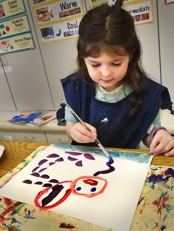 BRYAN EATON/Staff photo. Students in Sara Ramos's art class at the Amesbury Elementary School to paint what they wished, but using different colored and bright paints for their creations. Alli Barns, 6, created a singing woman while others painted rainbows, flowers and landscapes.