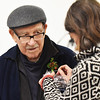 BRYAN EATON/Staff photo. Plante's daughter Susan Simon pins an evergreen corsage on before the ceremony.