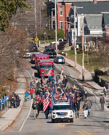 JIM VAIKNORAS/Staff photo The Amesbury Veterans Day Parade makes it's way up Main Street Saturday morning.