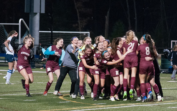 JIM VAIKNORAS/Staff photo The Newburyport girls soccer team celebrate their victory Monday. The Clippers defeated Lynnfield in Lynnfield 1-0 in overtime.