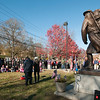 JIM VAIKNORAS/Staff photo People gather at the Doughboy Statue at Amesbury Middle School during the annual Veterans Day service Saturday.