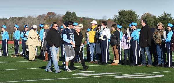 BRYAN EATON/Staff photo. Triton football, band and cheerleaders who are seniors were honored with their parents at the start of the Thanksgiving Day game with Pentucket.