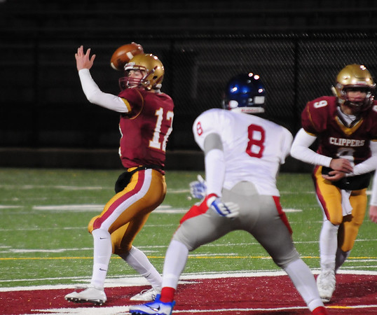 JIM VAIKNORAS/Staff photo Newburyport's Owen Bradbury completes a pass against Somerville at World War Memorial Stadium in Newburyport Friday night.