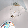 BRYAN EATON/Staff photo. Pieces of plaster have fallen and various areas of water damage are evident throughout the ceiling of the sanctuary.
