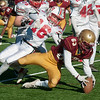 JIM VAIKNORAS/Staff photo Newburyport's Walter Bartlewicz and Amesbury's Troy Hamel dive for a loose ball at the Newburyport/Amesbury Thanksgiving football game at World War Memorial Stadium in Newburyport Thursday.