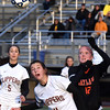 BRYAN EATON/Staff photo. Clipper's Margaret Cote clashes with a Wayland player.