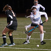 JIM VAIKNORAS/Staff photo Triton's Maggie Riccio makes a move against Ipswich at Triton Wednesday night.