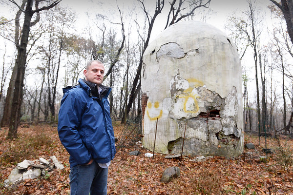 BRYAN EATON/Staff photo. History teacher Tim Osgood and others are hoping to restore and clean up the area around the old powderhouse off Madison Street in Amesbury.