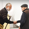 BRYAN EATON/Staff photo. Newbury selectman Geoffrey Walker presents BIll Plante with the Boston Post Cane.