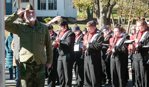 JIM VAIKNORAS/Staff photo Veteran Paul Jancewicz salutes during the playing of the National Anthem at Amesbury Middle School during the annual service Saturday.