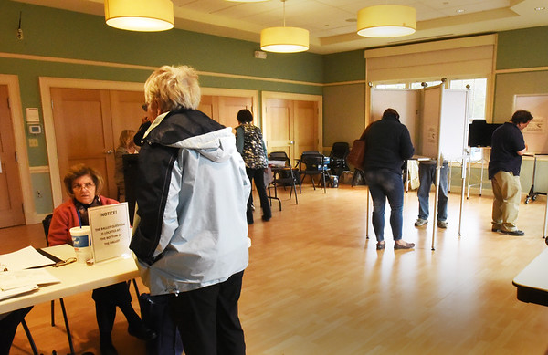 BRYAN EATON/Staff photo. Voters in Ward 6 in the Newburyport Senior Center was steady around noon time on Tuesday.