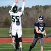 BRYAN EATON/Staff photo. Pentucket's Liam Murray tries to block a pass by Triton quarterback Thomas Lapham.
