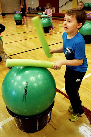 "BRYAN EATON/Staff photo. Hunter Bergeron, 5, gets into to they rhythm of ""Drums Alive"" program in physical education class at the Bresnahan School on Thursday afternoon. The program mixes music, learning along with excercise in this evidence-based physical activity."