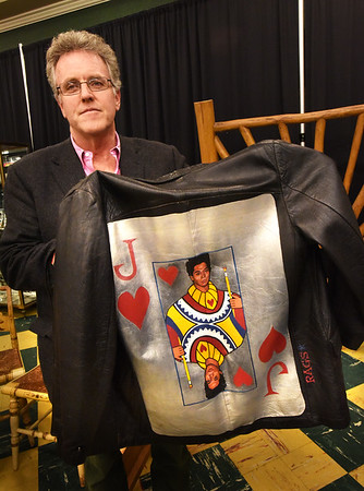 BRYAN EATON/Staff photo. Dan Meader of McInnis Auctioneers with jacket with the image of artist, and Warhol friend, Jean Michel Basquiat.