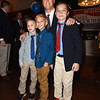 BRYAN EATON/Staff photo. Governor Charlie Baker poses with youngsters, from left, Michael DeRosa, 8, Dylan McLatchey, 10, and Nicholas DeRosa, 10, all of Amesbury at the Mission Oak Grill on Wednesday night. He was in town attending a fundraiser for state Rep. Jim Kelcourse.