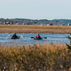 JIM VAIKNORAS/Staff photo A pair of kayakers paddle their way up Plumbush Creek as seem from the Parker River Wildlife Refuge in Newbury Saturday