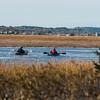 JIM VAIKNORAS/Staff photo A pair of kayakers paddle their way up Plumbush Creek as seem from the Parker River Wildlife Refuge in Newbury Saturday