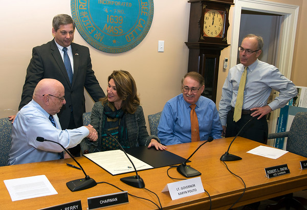 JIM VAIKNORAS/Staff photo 	Lt. Gov. Karyn Polito shakes hand with Rowley Board of Selectman Chairman Joseph Perry at Rowley Town Hall after signing a Community Compact. Behind them is Senator Bruce Tarr, next to them are Selectman Vice-Chairman Robert Snow and Selectman Clifford Pierce.