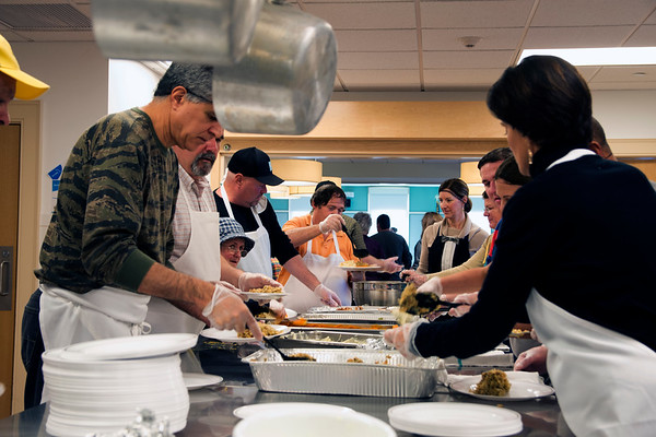 JIM VAIKNORAS/Staff photo Volunteers prepare turkey dinners at the Newburyport Lions Club Thanksgiving dinner at the Senior Center in Newburyport Thursday. About 70 volunteer served over 250 dinner at the annual event.