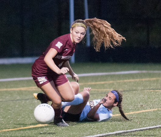 JIM VAIKNORAS/Staff photo  Newburyport's Cricket Good makes a play on the ball after colliding with a Lynnfield player during their game Monday. The Clippers defeated Lynnfield in Lynnfield 1-0 in overtime.