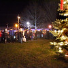 BRYAN EATON/Staff photo. Scores of people showed up for the lighting of the Christmas Tree in Salisbury Square on Sunday night. The lighting was preceded by the arrival of Santa Claus and music by the Salisbury Elementary School Band.