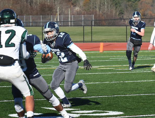 BRYAN EATON/Staff photo. Triton's Jack Tummino gets yardage on a short pass reception from quarterback Thomas Lapham.