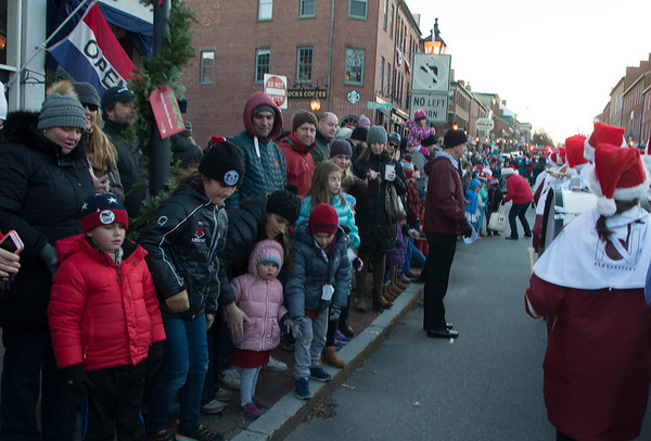 JIM VAIKNORAS/Staff photo Crowds line State Street for the annual Santa Parade and Tree Lighting in Market Square in Newburyport Sunday.