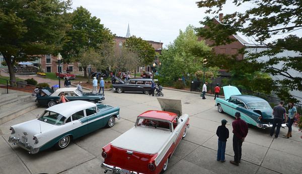 Amesbury: People check out the antique cars in the Millyard at teh annual Fall Festival in Amesbury Saturday. Jim Vaiknoras/staff photo
