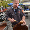 "Amesbury: Jonathan Kelley, AKA "" The Best"" of the Newbury Fire Dept. serves up some of the stations chili at the annual Firefighters' chili cookoff in the Barking Dog parking lot Saturday. Jim Vaiknoras/staff photo"