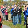 BRYAN EATON/ Staff Photo. Spectators along the Newburyport Rail Trail appplaud runners as they near the finish line.