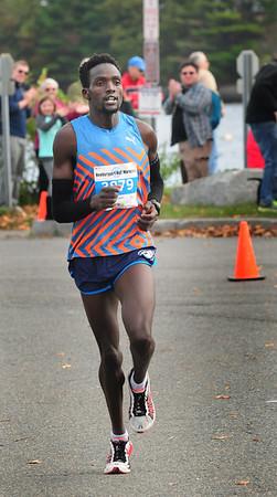 BRYAN EATON/ Staff Photo. Men's winner Amos Sang of Chicopee.