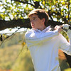 JIM VAIKNORAS/staff photo Triton's Sam Aponastees off at the 3rd at Old Newbury during River Rivals Golf Tournament.