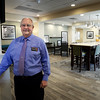 BRYAN EATON/Staff photo. Manager on duty Donald Roberts in the breakfast area of the new Hampton Inn.