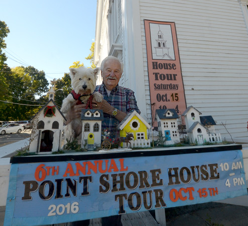 JIM VAIKNORAS/staff photo Jack Davidson and his dog Nellie with small houses he made representing houses on the Point  Shore in Amesbury.