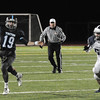 JIM VAIKNORAS/Staff photo Triton's Lewi L'Heureux looks for a reciever while being chased by Swampscotts Alex Sheehan at Triton.